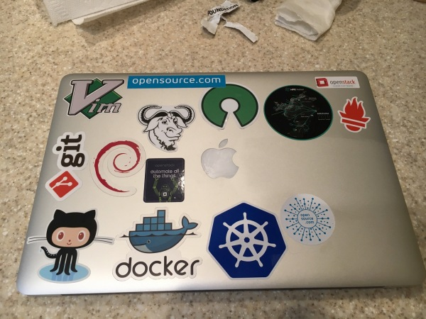 MacBook Pro with open source project stickers